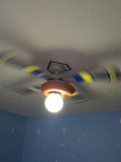 The baseball motif ceiling fan and light.